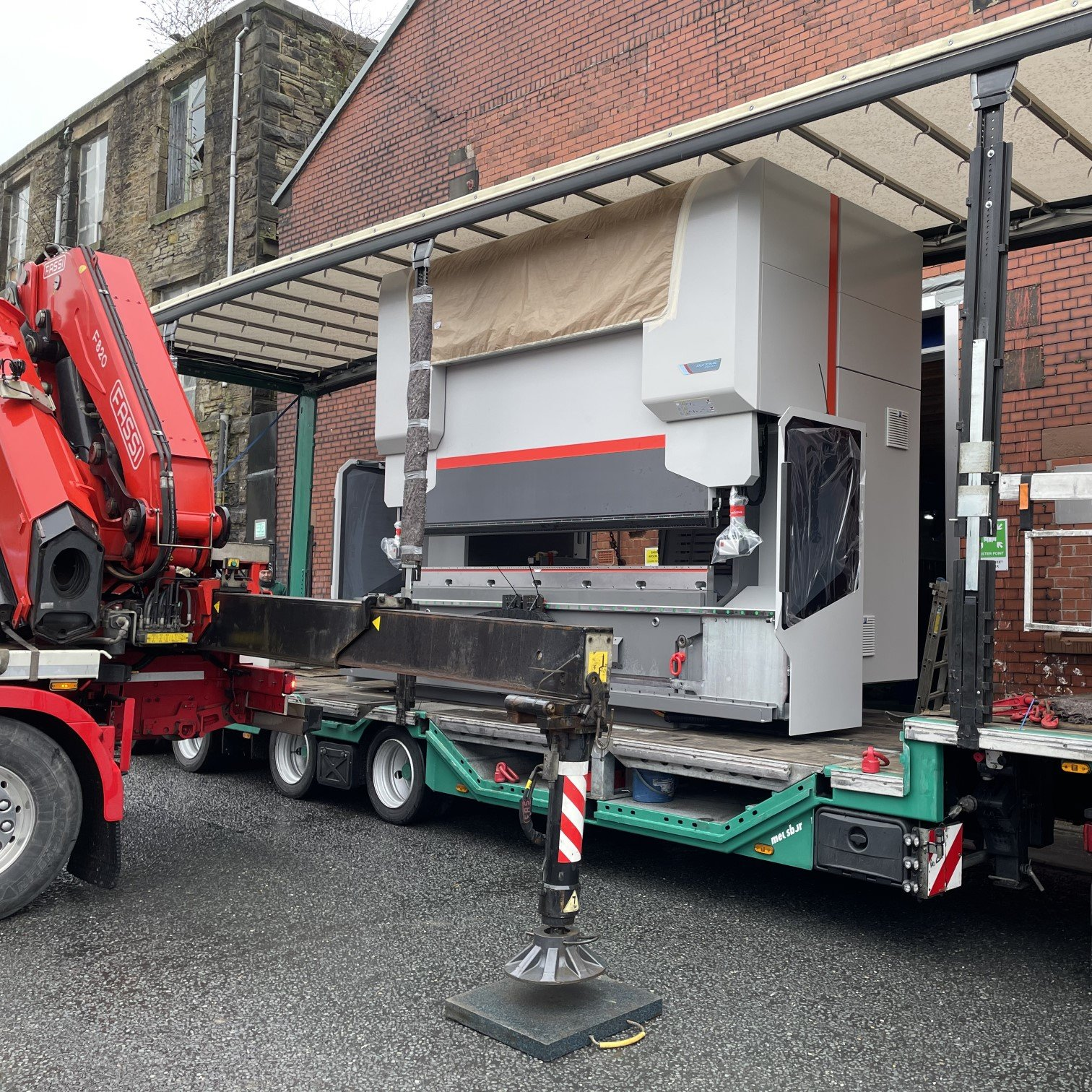 New press brake is offloaded from transport